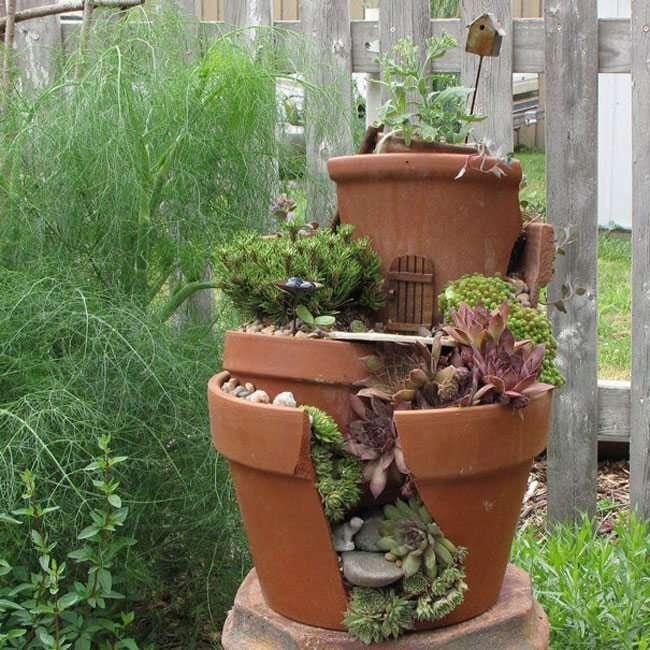 Idee per il giardino riciclo con vasi di terracotta 18 foto - Porta piante fai da te ...